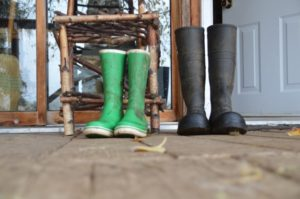 A pair of wellies outside a front door.