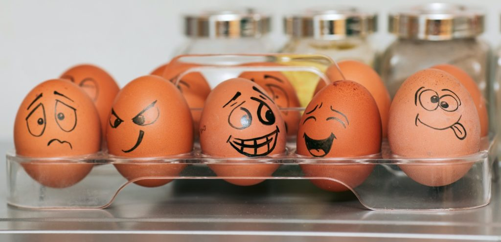 eggs with different emotional expressions on them.
