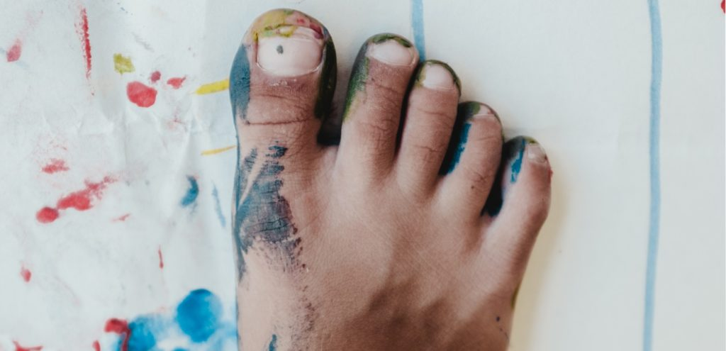 A foot covered in coloured paint