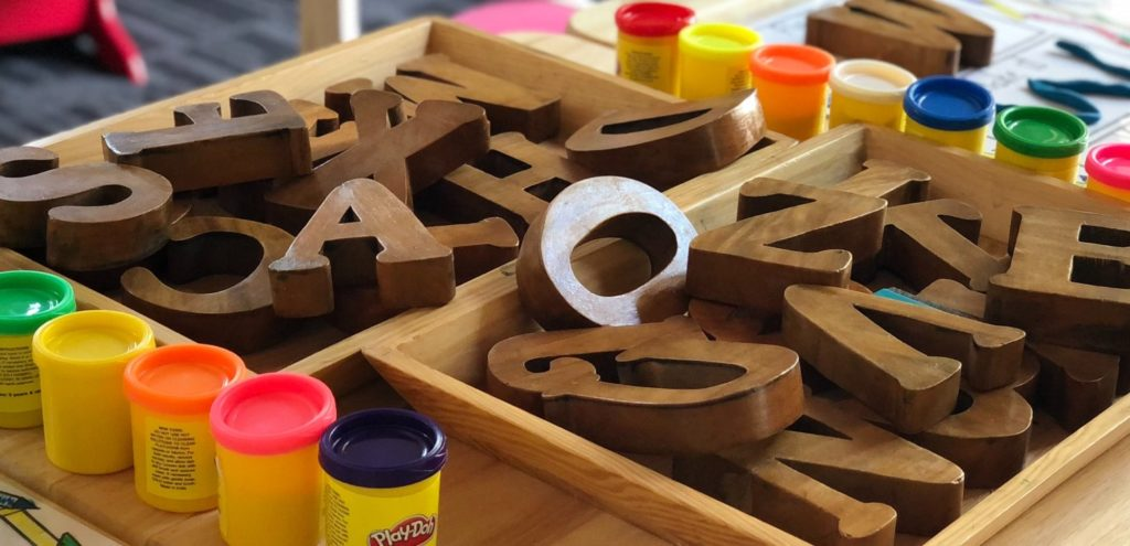 Wooden letters in a box