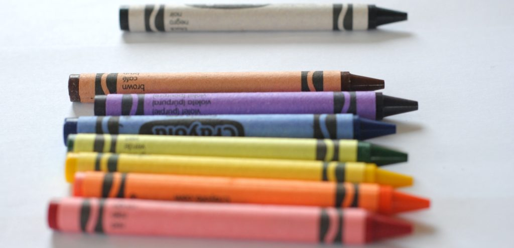 A row of colourful crayons