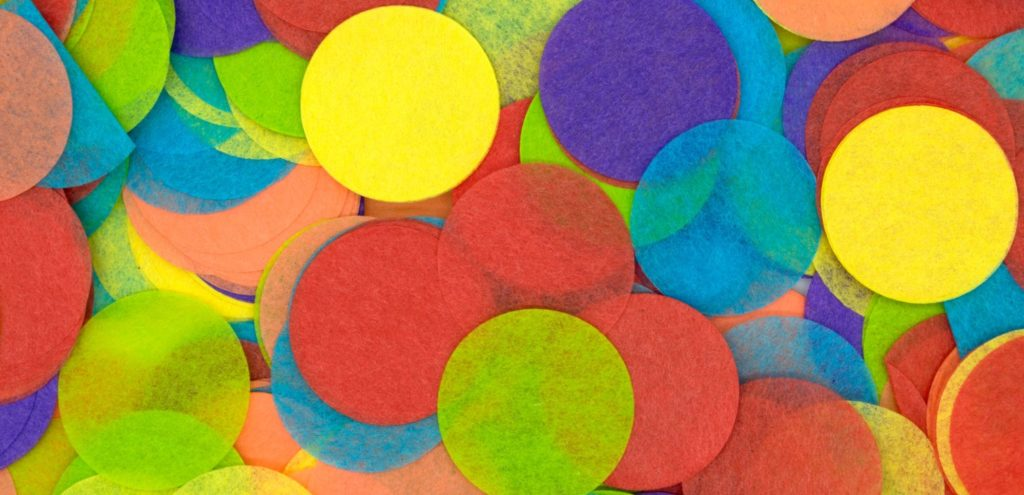a pile of multicoloured paper disks