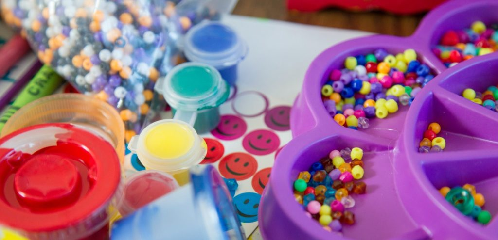 A table covered in craft supplies