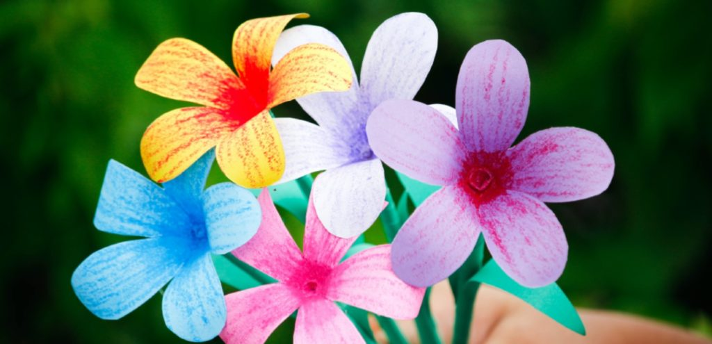 A buncg of coloured flowers made with paper.